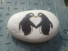 Penguin heart painted rock