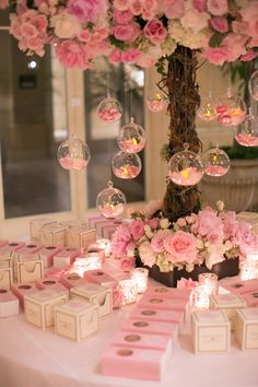 A pink flower arrangement featured suspended glass orbs filled with petals. #WeddingDecor Photography: Marianne Lozano Photography. Read More: http://www.insideweddings.com/weddings/pink-white-wedding-with-ombre-details-at-montage-laguna-beach/686/