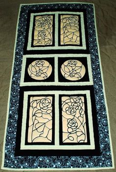 Advanced Embroidery Designs. Quilted table runner with stained-glass applique embroidery.