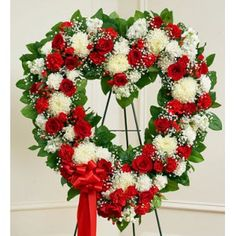 Unique Funeral Flowers | Funeral Flowers Heart Shaped Standing Arrangement.