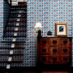 We spend comparatively little time in hall or stairways - so let them be bold! This retro bright blue and red geometric wallpaper speaks for itself ;)