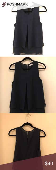 BCBG navy blue chiffon sleeveless blouse BCBG navy blue sleeveless blouse, high neck, multiple layer and flowy top. Never been worn BCBG Tops Blouses