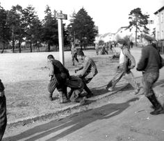 "Newly liberated inmates at Bergen-Belsen concentration camp chase down a former prison ""Kapo"" at Bergen-Belsen concentration camp, near Celle, Lower Saxony, Germany, 16th April 1945."