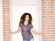 standing in doorway - Girl stands with her arms to the side in a doorway.   MUA - Wright Artistry