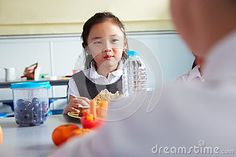 Girl Eating Healthy Packed Lunch In School Cafeteria Stock Photo - Image: 59773772