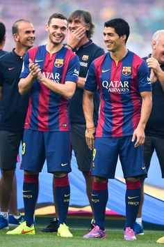 (L-R) Thomas Vermaelen and Luis Suarez of FC Barcelona shares a joke during the official presentation of the FC Barcelona prior to the Joan Gamper Trophy match between FC Barcelona and Club Leon at Camp Nou on August 18, 2014 in Barcelona, Catalonia.