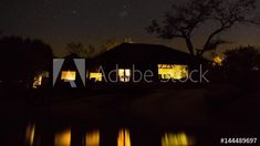 Stock Footage of A slow linear dolly shot of a luxurious private African safari lodge with the stars shinning brightly against the dark night sky while lights reflect in the swimming pool water. Explore similar videos at Adobe Stock Swimming Pool Water, African Safari, Dark Night, Milky Way, Night Skies, Stock Video, Stock Footage, The Darkest, Adobe
