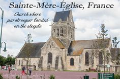 Sainte-Mère-Église, France is best known for the 700 year old medieval church where Private John M. Steele, a Airborne Paratrooper, hung on the steeple. Safari, Visit Utah, Paratrooper, He Is Able, Normandy, France Travel, Day Trip, Barcelona Cathedral, Medieval