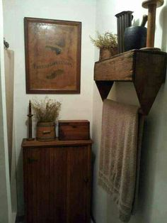 Old tool caddy as a shelf & towel bar - love it!!