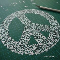 Peace Sign papercut by © Suzy Taylor 2013