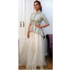 in the Ridhi Mehra CINCO bird print peplum jacket paired with a sharara Indian Fashion Dresses, Dress Indian Style, Indian Gowns, Indian Designer Outfits, Designer Party Wear Dresses, Kurti Designs Party Wear, Lehenga Designs, Peplum Top Outfits, Peplum Jacket
