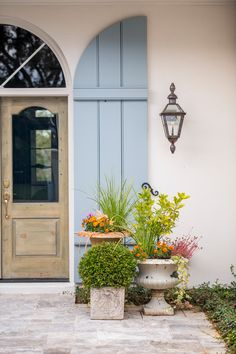 Love a large shutter at the front door and that is a gorgeous stained front door. georgianadesign: Mountain Lake renovation, Tampa. Clifford M. Scholz Architects.