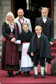 Crown Prince Haakon, and Crown Princess Mette-Marit of Norway, with Princess Ingrid Alexandra, and Prince Sverre Magnus, and Crown Princess Mette-Marit's son Marius Borg Hoiby (R) watch the traditional morning children's parade, at their home, Skaugum, in Asker, near Oslo, on Norway's National Day, on May 17, 2015 in Oslo, Norway