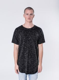 Jacob - Charcoal  $72.00    This shirt is made of a textured knit with dropped shoulders, slightly scooped front and an elongated rear. The Jacob has signature cut and sew detailing down the front and rear as well. It has a very clean vertical welted chest pocket. This shirt is a statement on its own alone or as a layering piece.     https://kollarclothing.com/collections/all/products/jacob-tee-charcoal