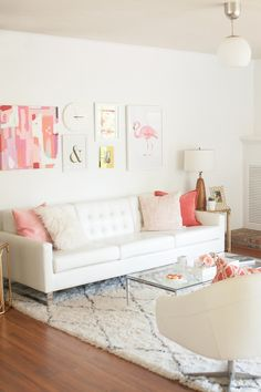 What's pink and white and lovely all over? Melissa Johnson's brand spankin' new living room is what! And we couldn't wait to get our hands on it. With a cozy rug underfoot and a pink gallery wall up above, this is one girly haven that's leaving us wanting more. To see it all in it's…