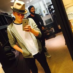 "Dad photobomb! Brooklyn Beckham may have just turned 16, but clearly he still enjoys hanging out with his old man! The David Beckham mini-me posed in a stylish hat, but his soccer-star father managed to steal the spotlight. ""Trying hats on"" he captioned his snap on March 14, 2015."