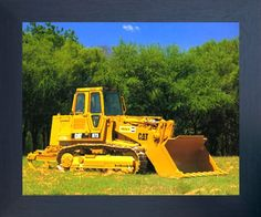 Deck up your interiors with this wonderful Caterpillar 973 track truck loader equipment print framed art poster. This framed poster captures the image of yellow Caterpillar track truck loader equipment which is sure to grab lot of attention and make this framed art a centre of attraction. This framed art poster will add a unique character to your room setting and goes with all décor style. Its wooden espresso frame accentuates the poster mild tone.