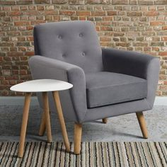 Mid Century Armchair | i love retro | Inspired by mid-century design and chic Scandinavian living, this sofa is where 1950s retro meets contemporary minimalism.  Button backed and complete with tapered solid oak legs. Available in Green or Smoke.  Perfect for your living room, conservatory or bedroom.