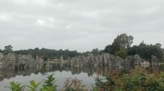 Reflections of Rock on Water at Stone Forest http://hub.me/aiNKA #travel #China #Yunnan