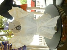 Ruffle sleeve top in white! Also available in Tangerine!