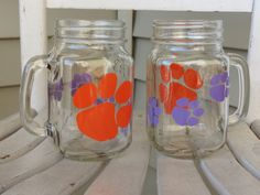 A personal favorite from my Etsy shop https://www.etsy.com/listing/237291089/set-of-two-clemson-paw-print-mason-jars