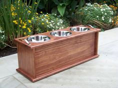 Dog bowl stand with food storage