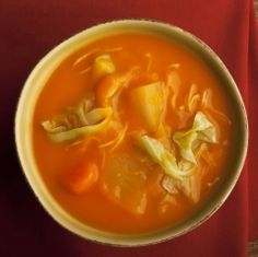 Haitian Pumpkin Soup - In Haiti, Squash Soup or 'Soupe Joumou', is a really a hearty stew of meat and squash that is traditionally eaten to celebrate the New Year. It is usually made with beef, but it is just as good made with the dark chicken meat, especially the thighs. The meat in this soup appears to be marinated twice. Let me explain: in much Caribbean cooking, meat is usually 'washed' in lime juice before cooking takes place, including marinating. This 'washi…