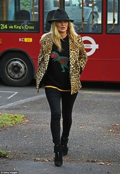 Autumn style: The top model injected plenty of fun into her look, teaming a cute dino-print sweater with one of her favourite wardrobe staples- a leopard print coat