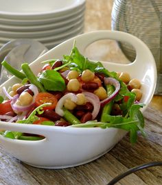 Delicious, easy Bean Salad with cherry tomatoes and rocket. How about this for a scrumptious treat on  Serve with crusty bread for mopping up the dressing. Light Recipes, My Recipes, Salad Recipes, Cooking Recipes, Healthy Recipes, Four Bean Salad, Classic Salad, South African Recipes, Home Food