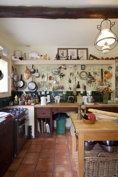 The kitchen at La Pitchoune. Much of Ms. Child's batterie de cuisine remains, including specialized implements, pots and pans. The stove at left rear replaces Ms. Child's cantankerous La Cornue. (Photo: Rebecca Marshall for The New York Times)