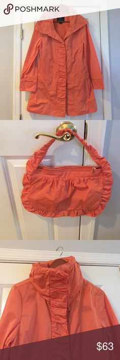 NEW!! Rainforest Raincoat Gorgeous Rainforest raincoat in Orange/Coral. Packable travel coat easy, wrinkle recovery. Comes with travel pouch. Hat hidden in collar. NEVER WORN!! Only reason I'm selling is because I have this in black also. rainforest Jackets & Coats
