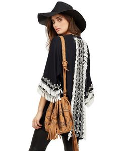 - Hand embroidered rayon kimono - Tasseled fringe detail - Three quarter length sleeve - Model is wearing a size Small Measurements (Small): 33in length, 21in sleeve length RESPONSIBILITY Cleobella's