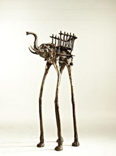 IMPERIAL WALKER, coat hanger. Cast brass in Dark Walnut finish.  arc-living.com