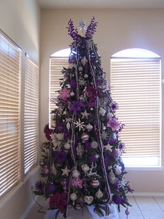 Our purple and silver Christmas tree 2011 Purple Christmas Tree Decorations, Best Christmas Lights, Peacock Christmas, Silver Christmas Tree, Decorating With Christmas Lights, Beautiful Christmas Trees, Christmas Love, Christmas Colors, Christmas Ideas