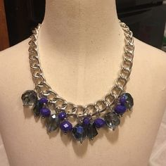 "Big Gem Necklace Beautiful silver toned necklace with blue gems and purple beads. This has a good amount of weight to it. This measures about 20"" plus a 3"" extender. New! Jewelry Necklaces"
