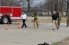 Jase drags heavy hose during one of the drills