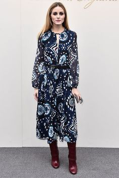 Olivia Palermo wears a paisley print belted dress and knee-high boots