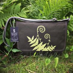 Handcrafted canvas messenger bag with a Fiddlehead Fern print on the flap and an entomology print lining.