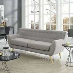 This modern piece in a soft, versatile gray will be a welcome addition to your living room, whatever your style.