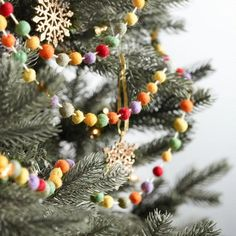 Dress your tree, mantel or tablescape with our handcrafted felt garland from India, featuring fuzzy, multicolored pompoms for a homespun, vintage look. Retro Christmas Tree, Bohemian Christmas, Christmas Tree Garland, Christmas Tree Themes, Christmas Mantels, Christmas Love, Christmas Holidays, Christmas Crafts, Country Christmas