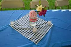 Table settings, peonies, roses and gardenias in pink ribbon wrapped mason jar. Backyard BBQ bridal shower.