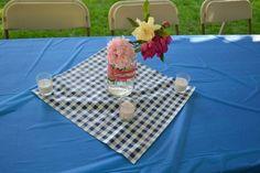 Table settings, peonies, roses and gardenias in pink ribbon wrapped mason jar. Backyard BBQ bridal shower.
