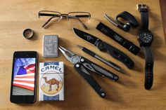 Spectacles wedding ring Phone 5 Zippo (engraved) Camel Blues Leatherman Charge Zebra F-402 pen Ontario RAT II Streamlight ProTac 2L Plantronics Voyager II bluetooth Timex brand timepiece