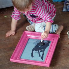 """Use brushstroke paper found at art supply stores and an old frame (glue paper to existing cardboard in frame).  Kids use water and foam brush to """"paint"""" then when it dries it goes back to normal paper, ready to use again"""