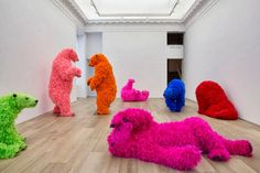 Paola Pivi's colorfully feathered bears inhabit Galerie Perrotin..