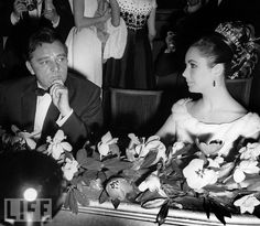 The Early Days  In 1962, Burton and Taylor attend the Paris gala celebration for the film Lawrence of Arabia.