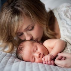 On bed with mom.  Photo credit: Acres of Hope Photography