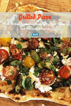 For this pizza, I split cherry tomatoes in half and toss them on the grill just until they start to lightly soften and turn juicy. Then I match them with asparagus that's grilled until charred and tender-crisp, along with fresh goat cheese, sliced Marcona almonds, and chopped basil. There's a lot going on here, but it's been one of my favorite pies so far.