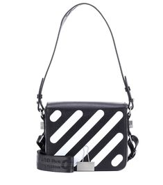 Off-White - Binder Clip leather shoulder bag - Off-White's Binder Clip leather shoulder bag features a number of the label's signature industrial-inspired elements. Crafted in Italy from textured black leather, this style is adorned with a white striped motif, finished with silver-tone hardware details and comes complete with a detachable yellow crossbody strap. Wear yours to inject looks with a dose of urban-cool. seen @ www.mytheresa.com