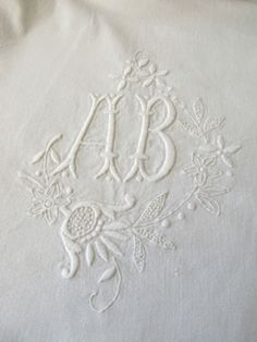 white embroidery monogram letter A and B